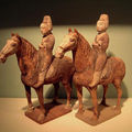 A pair of chinese tang dynasty painted pottery horses and riders. china, tang dynasty