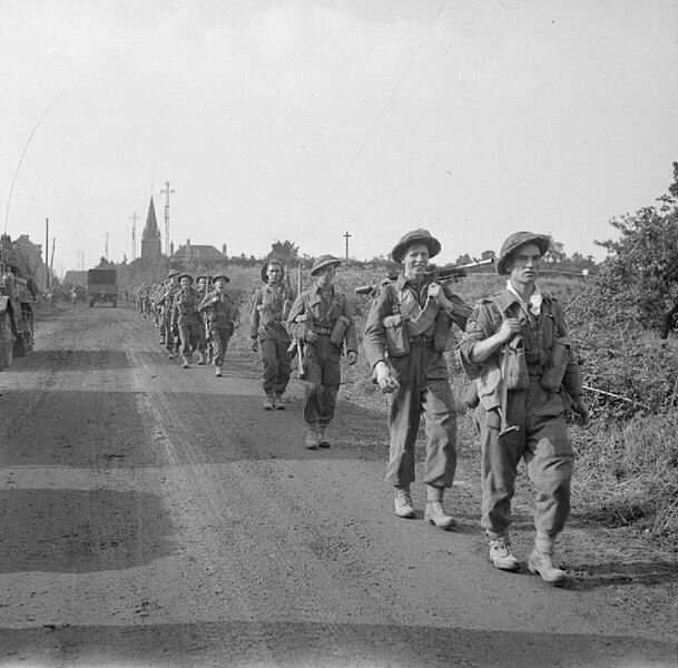 609px-Royal_Scots_advancing_03-08-1944