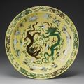 A large green and aubergine yellow-ground biscuit charger. kangxi mark and period
