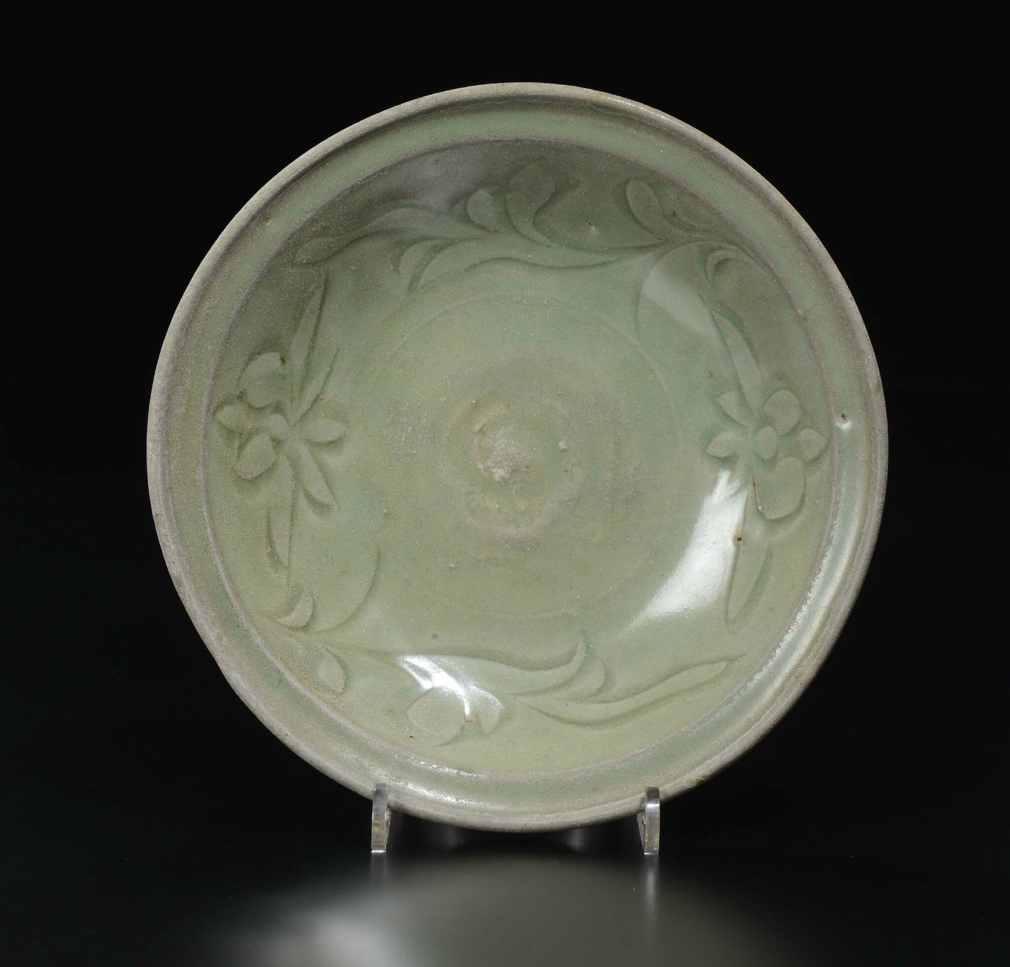 A Celadon porcelain dish with naturalistic decoration, China, Ming Dynasty, 16th century