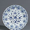 A fine blue and white barbed 'flower scroll' dish