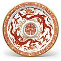 A very rare iron-red-decorated sgraffiato 'dragon' cup and saucer, qianlong marks and period (1736-1795)