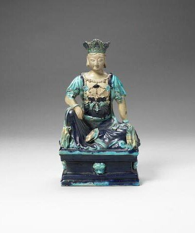 A turquoise and aubergine-glazed figure of Guanyin, Ming Dynasty