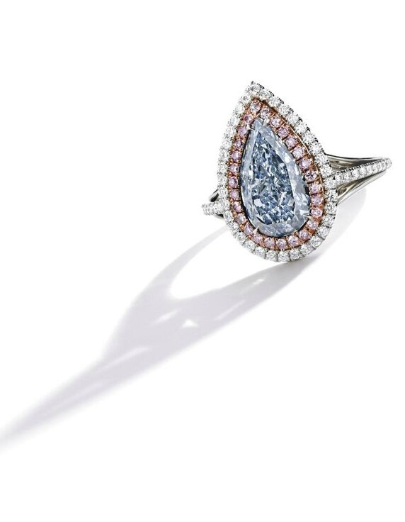 Platinum, 18 Karat Rose Gold, Fancy Light Blue Diamond and Diamond Ring