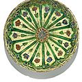 An iznik polychrome pottery dish with arched floral stems, turkey, 17th century