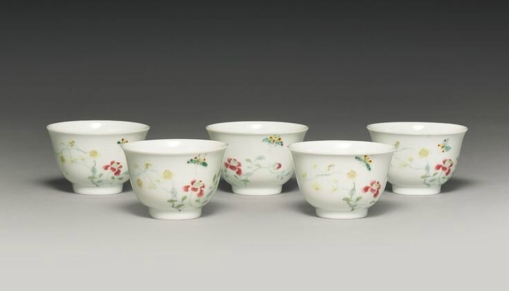 A fine group of five 'boneless' Famille-Rose winecups, Yongzheng marks and period