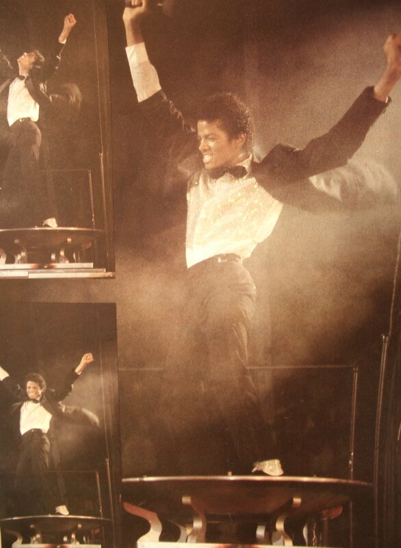 Michael_Jackson_Magic_book_hands_in_air