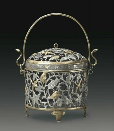 A rare parcel-gilt silver reticulated basket-form vessel and cover, China, Tang dynasty (AD 618-907)