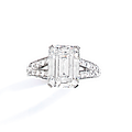 A diamond and platinum ring by boucheron set with an emerald-cut diamond weighing 5,25 cts