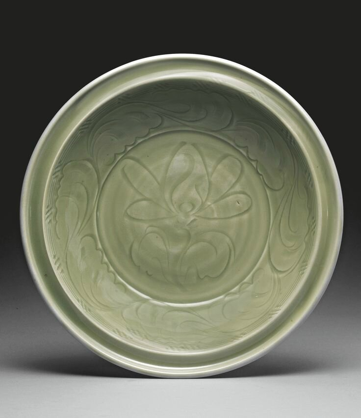 A fine carved 'Longquan' celadon 'Lotus' dish, Yuan dynasty
