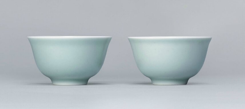 A pair of small celadon-glazed cups, Jiaqing six-character seal marks in underglaze blue and of the period (1796-1820)