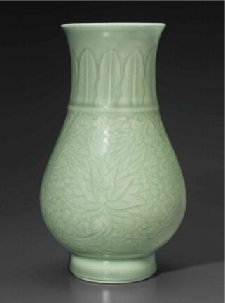 A celadon-glazed carved pear-shaped vase, China, Qing dynasty, Kangxi period (1662-1722)