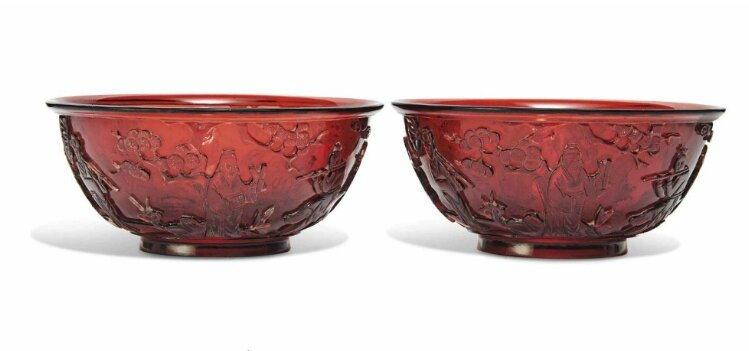 A pair of Chinese red glass 'Immortals' bowls, 19th-20th century