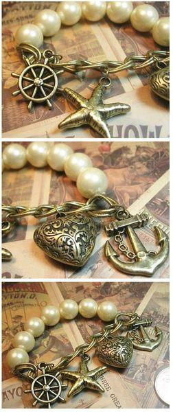 Bracelet Elastique Marina Perles Nacrées Blanches Breloques Métal Couleur Bronze