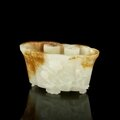 A fine and rare white and russet jade 'lingzhi fungus' washer, qianlong