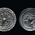 Two silver-plated bronze mirrors, china, han period (206 ac -220 dc)
