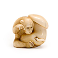 A tinted ivory netsuke of a monkey. by rantei, 19th century