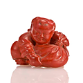 A red lacquer netsuke of a chinese boy. by ryukei, 19th century
