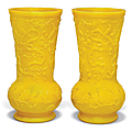 A pair of yellow glass vases, 20th century