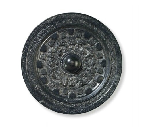 A bronze circular mirror with deities and animals, China, Mid-late Eastern Han Dynasty, Late 2nd-3rd century AD