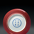 A small copper-red-glazed dish, China, Qing dynasty, Yongzheng six-character mark in underglaze blue within a double circle and of the period