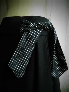 detail faux potefeuille jupe noued t40