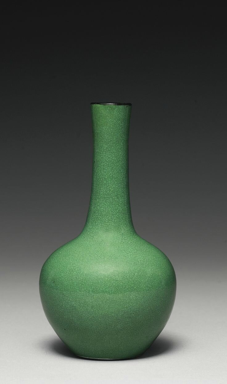 A small apple-green-glazed bottle vase, Qing dynasty, 18th century