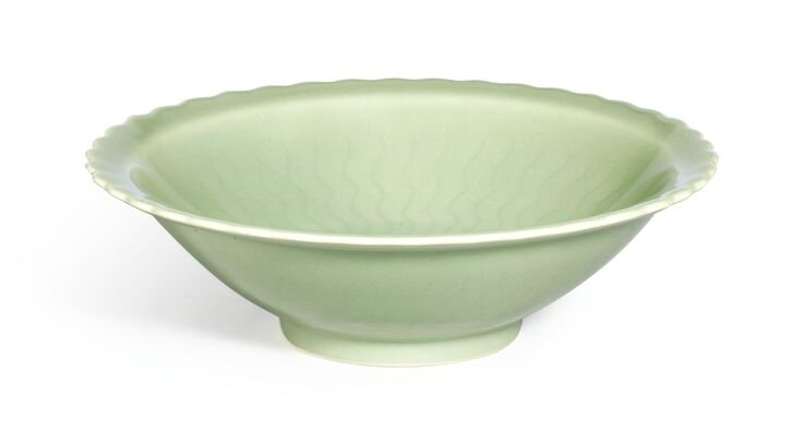 A fine incised celadon-glazed bowl, Seal mark and period of Qianlong
