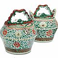 A pair of chinese famille verte watering pots and covers, second half 17th century