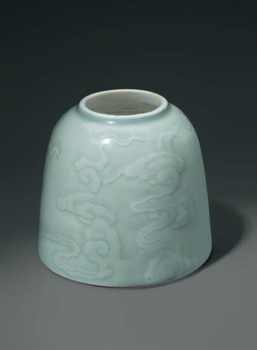 A celadon-glazed carved domed water pot, China, Qing dynasty, 18th century
