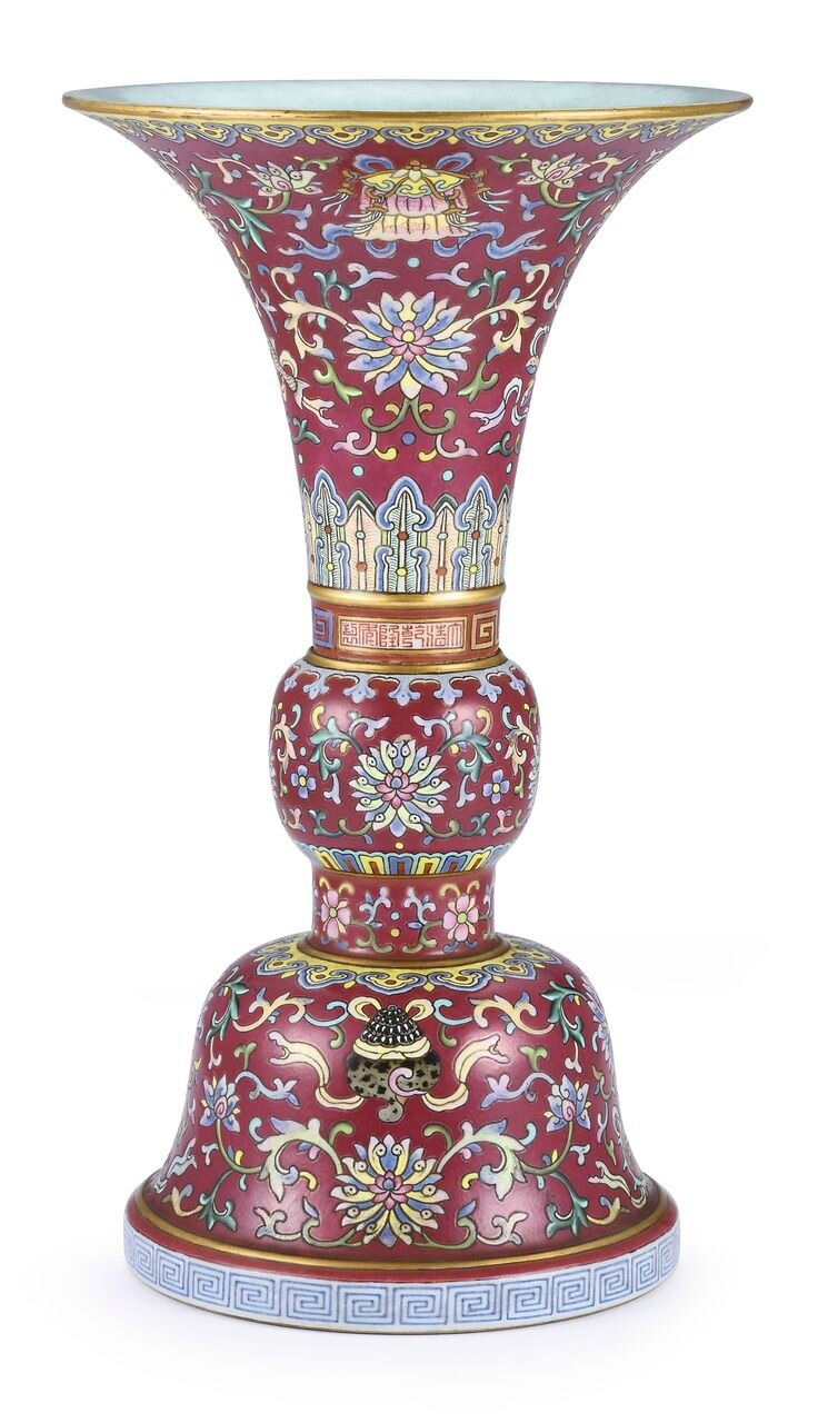 A fine ruby-ground famille-rose 'Bajixiang' altar vase, gu, Seal mark and period of Qianlong