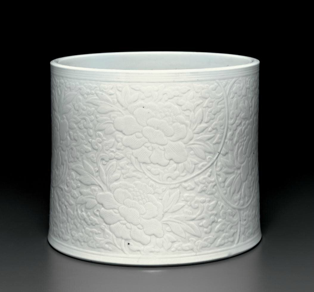 A white-glazed carved cylindrical brush pot, Kangxi period (1662-1722)