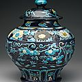 A rare molded and reticulated fahua jar and cover, ming dynasty