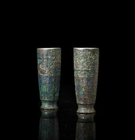 A rare and unusual pair of inlaid bronze beakers, Warring States period