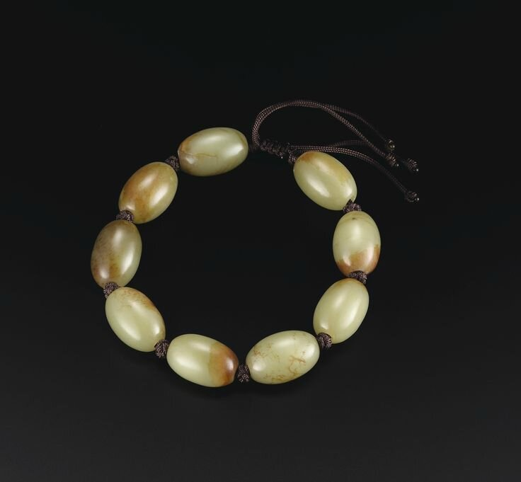 A Rare Yellow and Russet Jade Rosary Bracelet, 17th Century