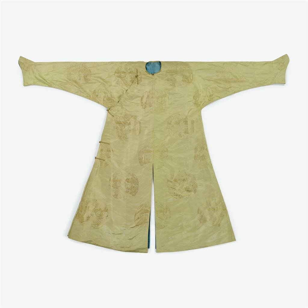 A Chinese lime green brocade silk robe decorated with landscape medallions throughout, 19th century