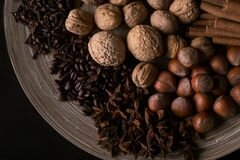 ingredients-baking-cinnamon-sticks-star-anise-cloves-nuts-coconut-coffee-beans-wooden-background-ngredients-67793538