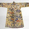 A yellow satin brocade dragon chuba, tibet, 19th century