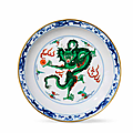 A rare imperial doucai 'dragon' dish, yongzheng six-character mark and of the period (1723-1735)