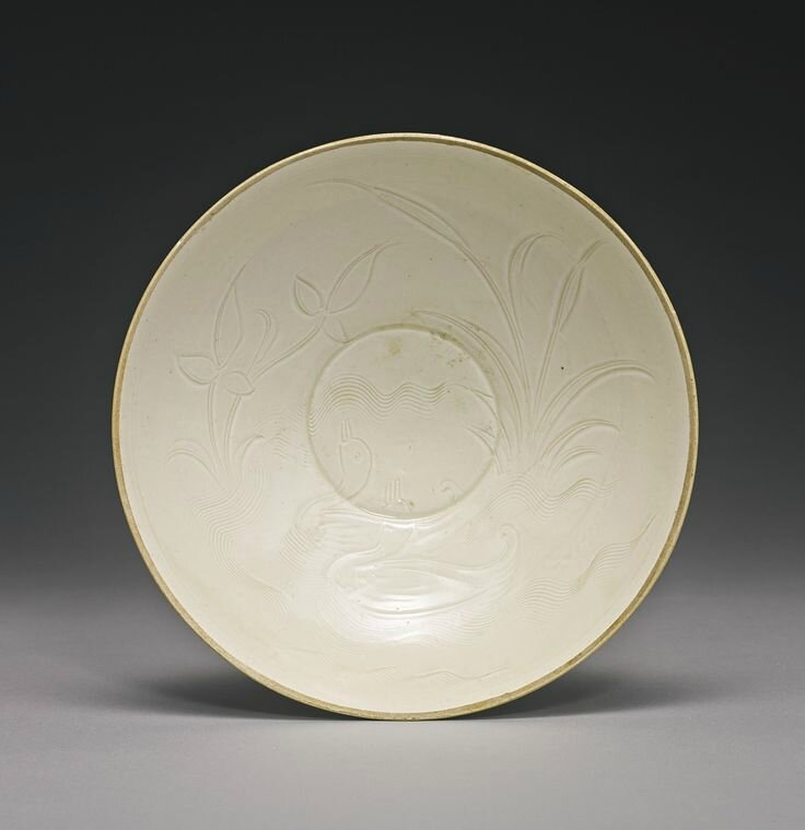 A carved 'Ding' 'Lotus and Duck' bowl, Northern Song dynasty