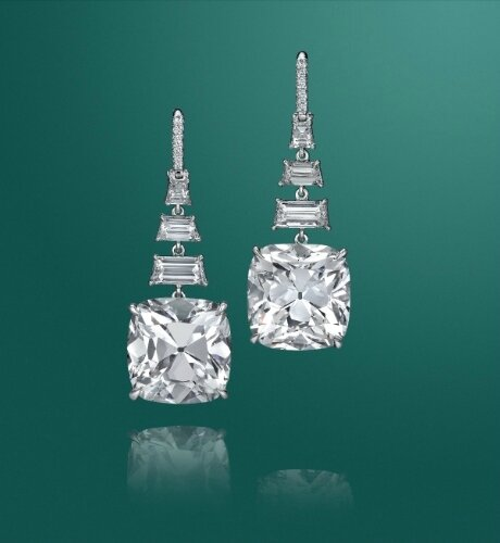A pair of impressive diamond ear pendants