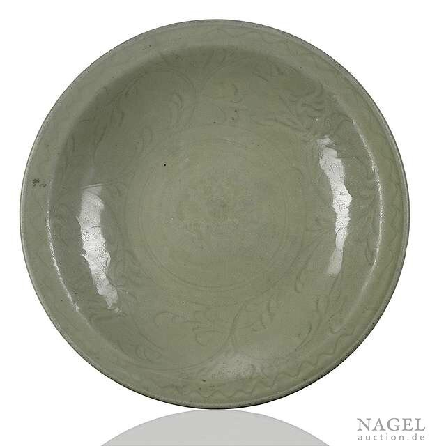 A Longquan celadon-glazed bowl with engraved lotus, China, early Ming dynasty