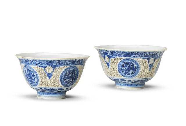 A rare pair of blue and white reticulated cups, Wanli six-character marks and of the period