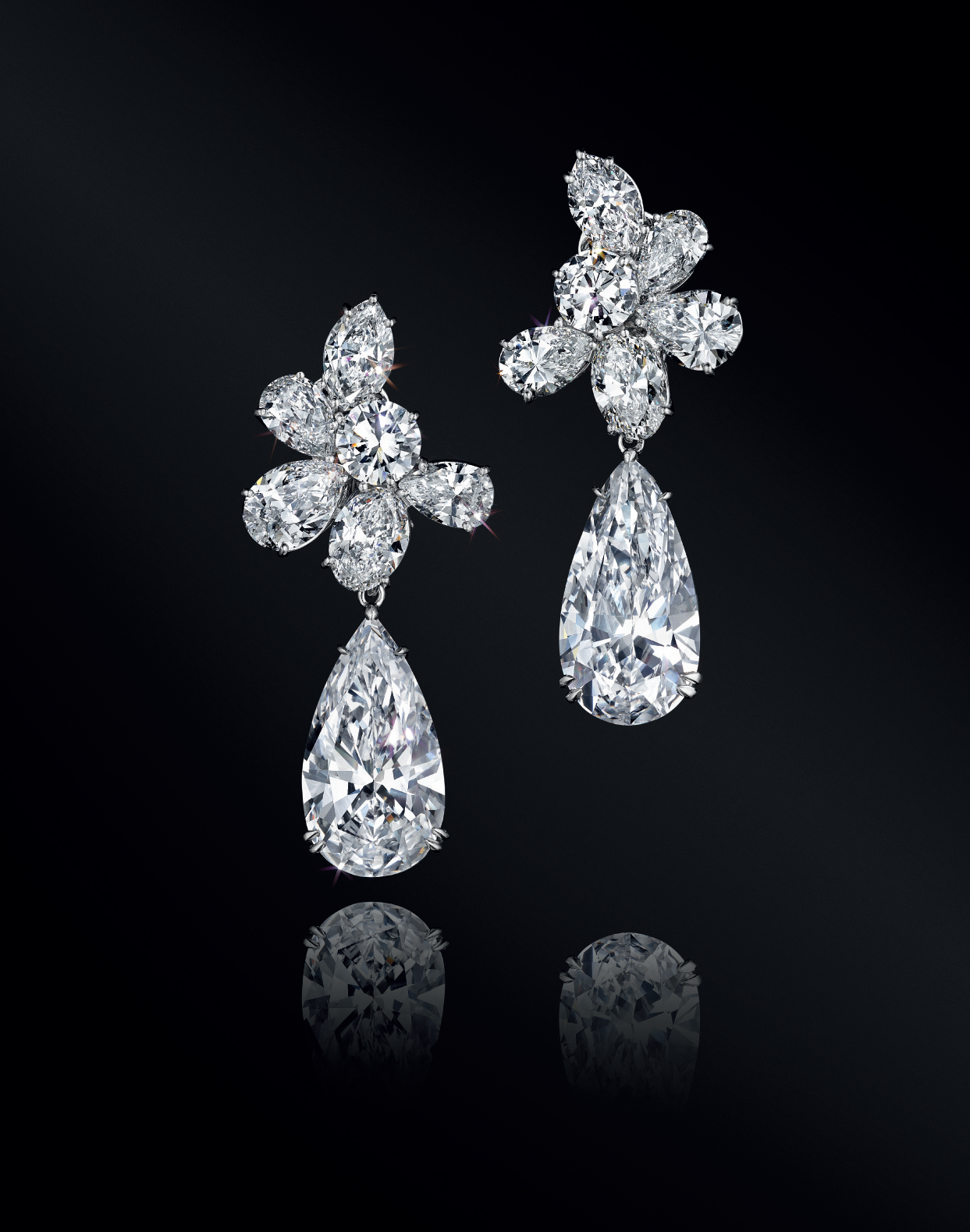 A pair of superb diamond ear pendants, by Harry Winston