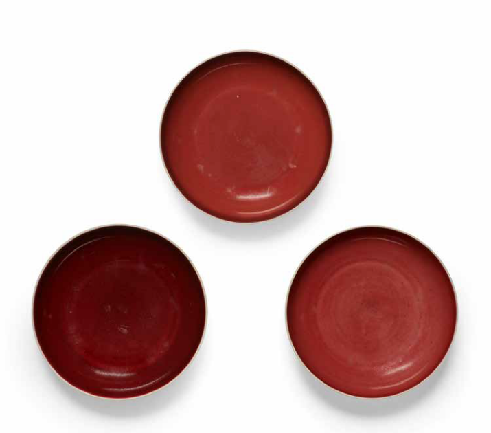 Three copper red dishes, Qianlong seal marks and of the period (1736-1795)