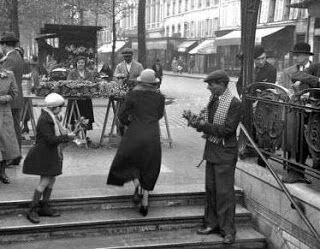 vendeur de muguet vers 1930