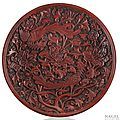 A very rare red lacquer saucer-dish of shallow form, China, early Ming dynasty (1368-1644), probably late 14th century.