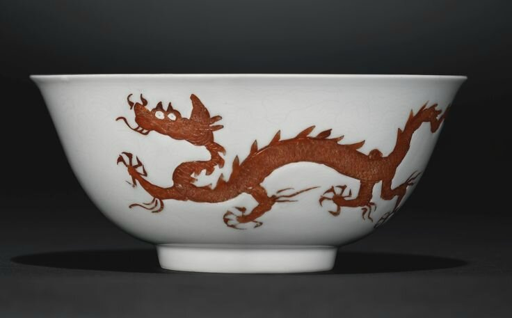 An extremely rare iron-red enamelled 'Dragon' bowl, Hongzhi mark and period (1488-1505)