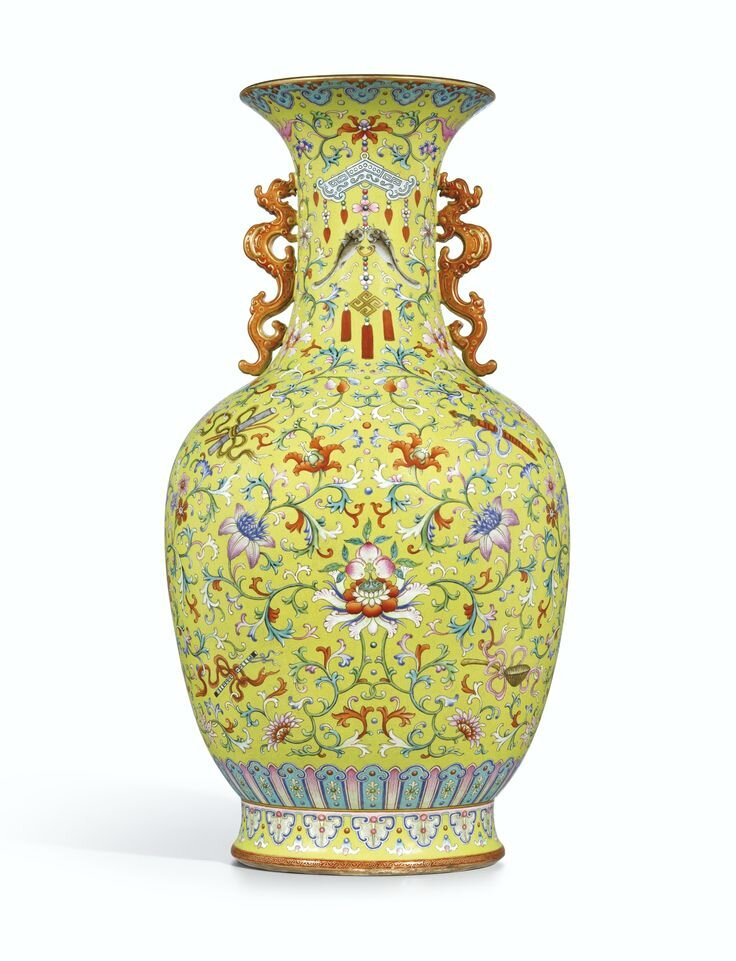 A magnificent yellow-ground famille-rose 'Anbaxian' sgraffiato vase with dragon handles, seal mark and period of Qianlong