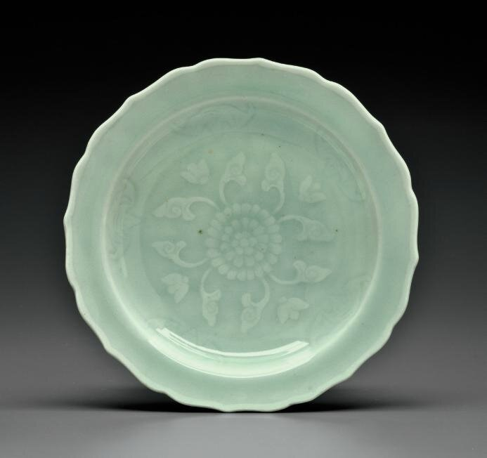 A small celadon-glazed flower-form dish, Qianlong six-character seal mark in underglaze blue and of the period (1736-1795)